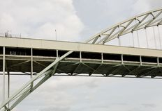 Graceful section of steel archway traffic bridge Stock Photos