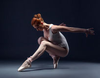 Graceful slender ballerina dancing in studio Stock Photo