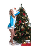 Graceful Snow Maiden posing with decorated fir Stock Image