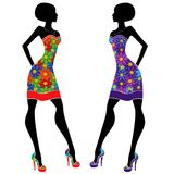Graceful young ladies in short dresses. Graceful stylish young ladies in short dresses with motley multicolor flowers, vector stencils isolated on the white vector illustration