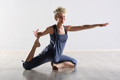 Graceful supple young woman doing exercises Royalty Free Stock Photography