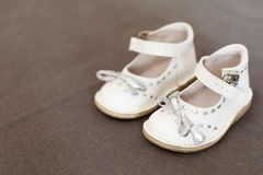 Shoes child. Graceful white shoes from child with ribbons Stock Photo