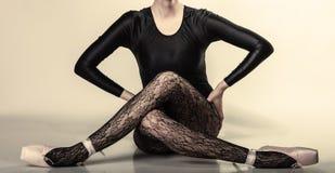Graceful woman ballet dancer. Graceful beautiful woman ballet dancer studio shot gray background Royalty Free Stock Images