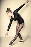 Graceful woman ballet dancer full length. Graceful beautiful woman ballet dancer full length studio shot  gray background Royalty Free Stock Photography