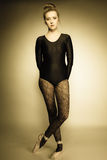 Graceful woman ballet dancer full length. Graceful beautiful woman ballet dancer full length studio shot sepia vintage aged tone Royalty Free Stock Photos