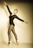 Graceful woman ballet dancer full length. Graceful beautiful woman ballet dancer full length studio shot sepia vintage aged tone Stock Photography