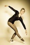 Graceful woman ballet dancer full length. Graceful beautiful woman ballet dancer full length studio shot sepia vintage aged tone Stock Photo