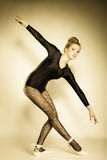 Graceful woman ballet dancer full length. Graceful beautiful woman ballet dancer full length studio shot sepia vintage aged tone Stock Images