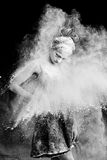 Graceful woman dancing in cloud of dust Royalty Free Stock Photo