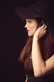 Graceful woman in elegant black hat with wide brim. Portrait of a beautiful graceful woman in elegant black hat with a wide brim. Red lips. Beauty, fashion stock images