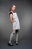 Graceful woman in grey dress Royalty Free Stock Images