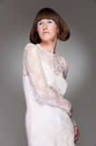 Graceful woman in guipure dress Royalty Free Stock Photo