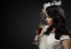 Graceful woman holding glass of wine Royalty Free Stock Photos