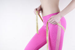 Graceful woman measuring your hips. Stock Photography