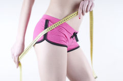 Graceful woman measuring your hips. Stock Images