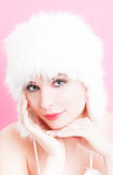 Graceful woman with perfect skin and fur hat Stock Photos