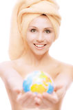 Graceful woman stretches globe Stock Photography