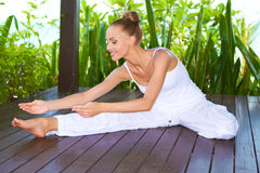 Graceful woman stretching doing yoga Royalty Free Stock Image