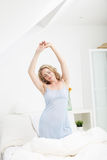 Graceful woman stretching in the morning Stock Photo