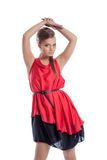 Graceful young girl posing in satin red dress Royalty Free Stock Photography