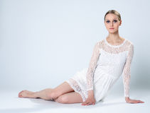 Graceful young girl posing in white lace dress Royalty Free Stock Image