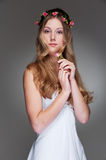Graceful young woman with flowers Stock Images