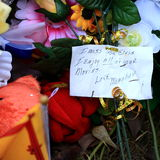 Note. From one of Elvis' fans on the flowers put by his grave in Graceland Memphis USA Royalty Free Stock Photos