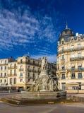Gracerna för Fontaine des Trois på stället de la Comedie i Montpellier Arkivfoto