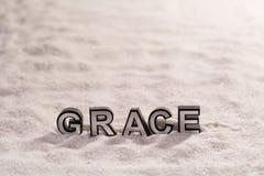 Graci słowo na białym piasku Zdjęcia Royalty Free