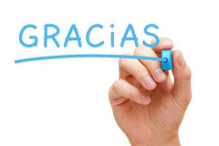 Gracias Blue Marker. Hand writing Gracias with blue marker on transparent wipe board Stock Photography