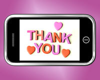 Gracias el mensaje y de los corazones como gracias enviadas en móvil Fotografía de archivo