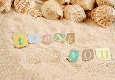 Gracias en la arena Imagen de archivo libre de regalías