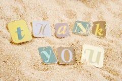Gracias en la arena Foto de archivo libre de regalías