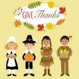 Gracias felices que dan con el peregrino y el traje indio rojo Imagen de archivo libre de regalías