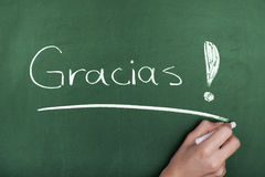 Gracias. Hand writing Gracias on chalkboard Royalty Free Stock Photos