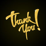 Gracias - las letras de la mano del brillo del oro en negro Imagen de archivo libre de regalías