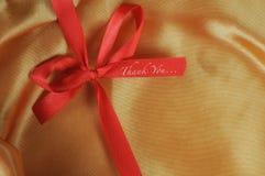 Gracias redactar en cinta roja Imagen de archivo libre de regalías