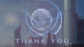 Gracias texto con el holograma 3d de la tierra del planeta contra el contexto de la metrópoli moderna