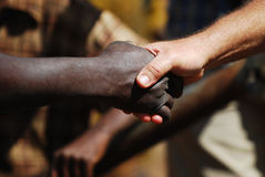 Gracias a través de barreras raciales Fotografía de archivo libre de regalías