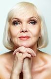 Gracious smile. Mature lady looking calmly at camera royalty free stock images