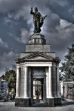 Graco style monument with the statue pointing the finger Royalty Free Stock Photography
