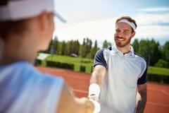 Graczów w tenisa witać fotografia royalty free