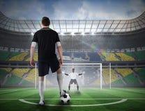 Gracz futbolu wokoło brać karę Obraz Royalty Free