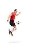 Gracz futbolu wykonuje tęcza prztyczek Obrazy Stock