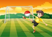 Gracz kopie piłkę z Indonezja flaga Zdjęcia Stock