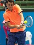 Gracz w tenisa Bernard Tomic narządzanie dla australianu open przy Kooyong klasykiem Zdjęcie Royalty Free