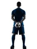 Gracza piłki nożnej mężczyzna trwanie sylwetka odizolowywająca z powrotem Obraz Royalty Free