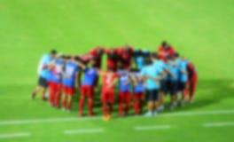 Gracze futbolu i personel zachęcać (plama skutka fotografia) Obrazy Stock