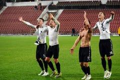 Gracze piłki nożnej świętuje zwycięstwo Obrazy Royalty Free