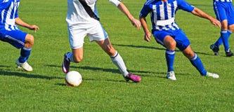 Gracze piłki nożnej w akci Zdjęcia Royalty Free